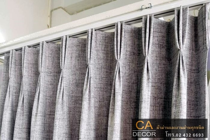 Pleated curtain rail